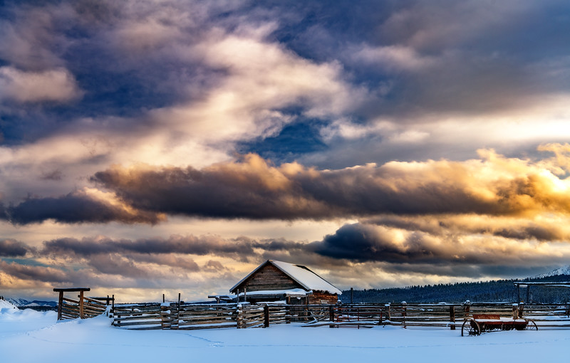 Warm colors of sunset form over a mountain Corral near Stanley  Idaho