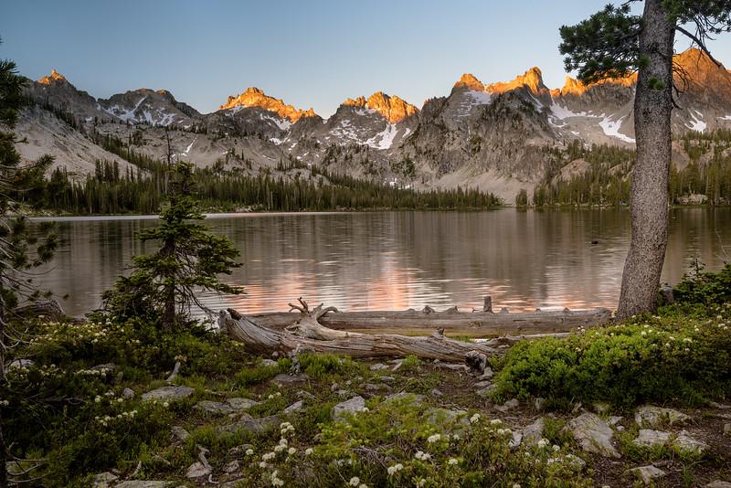 First light hits the peaks aroudn Alice Lake Idaho