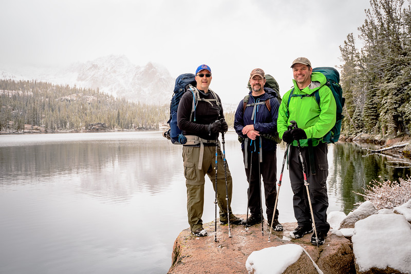 Hikers pose for a shot at Imogene Lake Sawtooth Mountains of Idaho