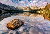 Cloud  reflections and rock Alice Lake Idaho