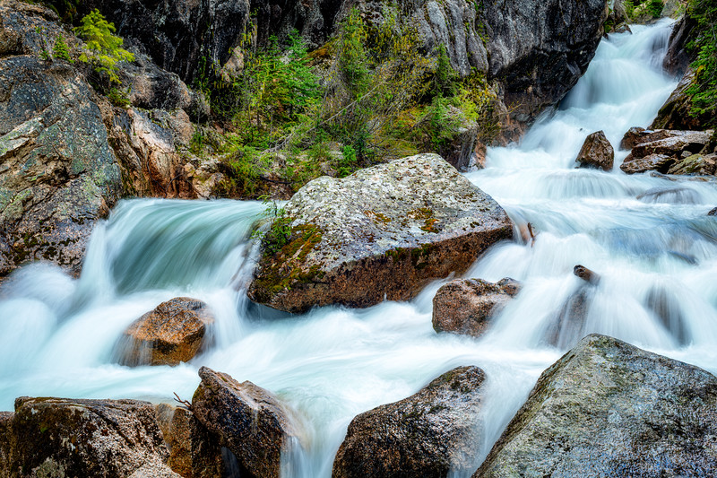 Water motion blur over rocks and through a canyon in nature
