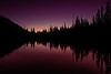 Idaho mountain lake first light colored sky and reflection