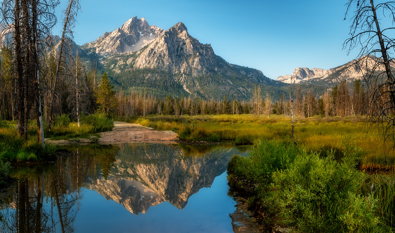 Iconic McGown peak reflection in flooded road
