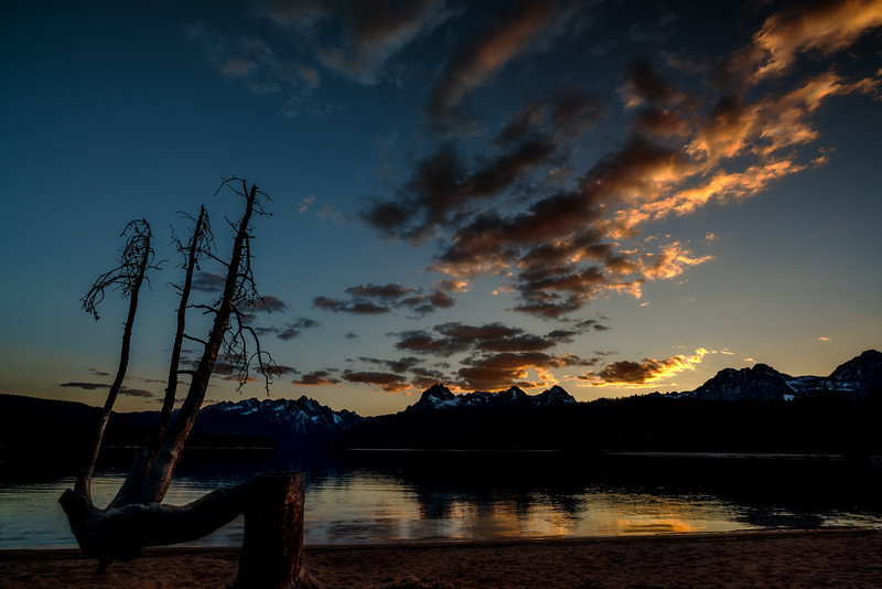Colors of evening over Redfish Lake with tree stump
