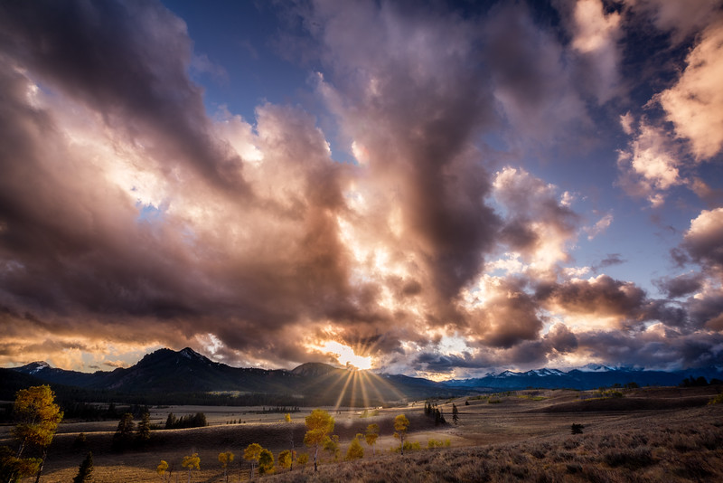 Sunset in the Sawtooth valley with a sunstar and clouds