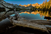 First light on Alice Lake with log in water
