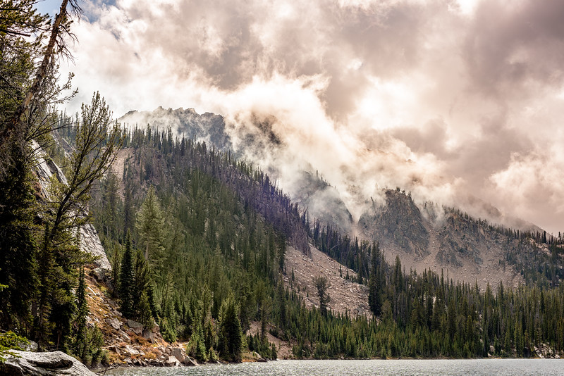 Clouds clear off of the mountain peaks around Imogene lake