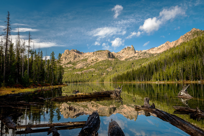 Monring clouds and logs at Hell Roaring Lake Idaho