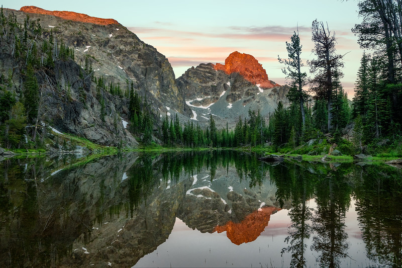 He Devil peak reflects in the pond near Sheep Lake Alpen GLow of sunrise