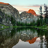 He Devil peak reflects in the pond near Sheep Lake Alpen GLow of sunrise