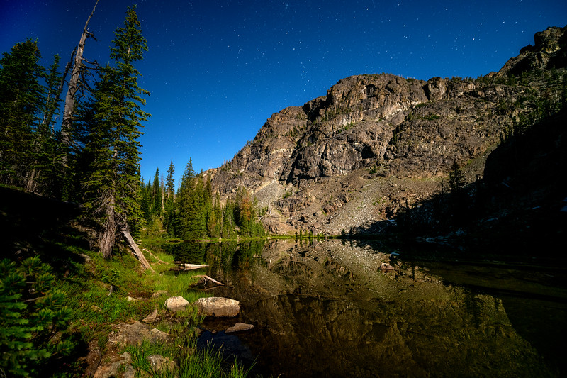 Peak above pond near Sheep Lake lit by moon light