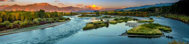 Sunset on the Snake River in Swan Valley with fishing boat