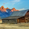 First light on the Grand Teton with Barn and autumn trees