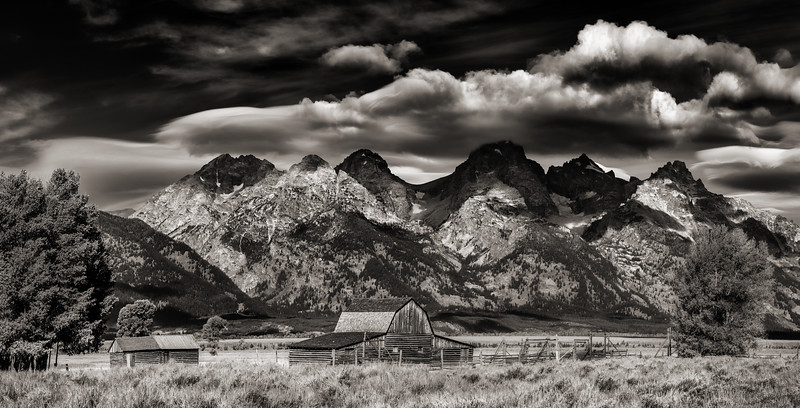 Old Barn in the Teton Valley with the Grand backdrop and dramatic clouds