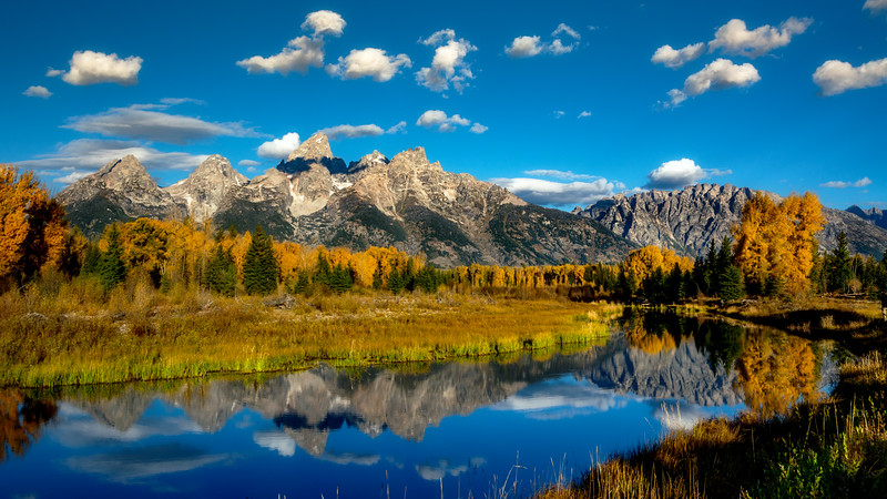 Morning Tetons in autumn with reflection