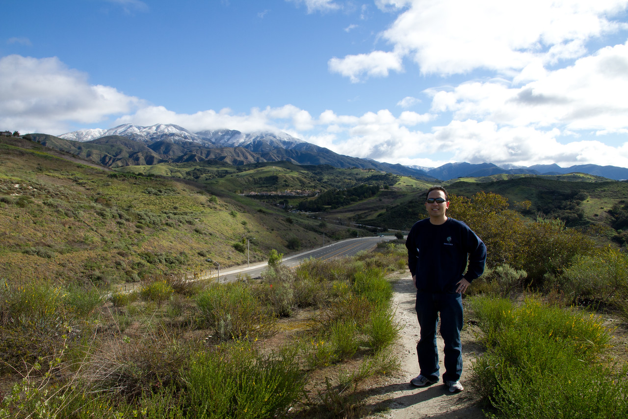 Self portrait in front of snow capped Saddleback Mountain