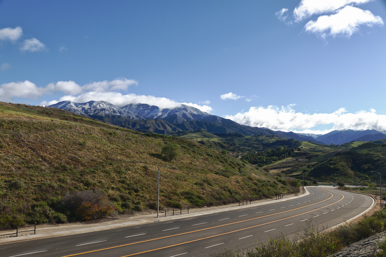 Glen Ranch Road with snow capped Saddleback Mountain in the distance