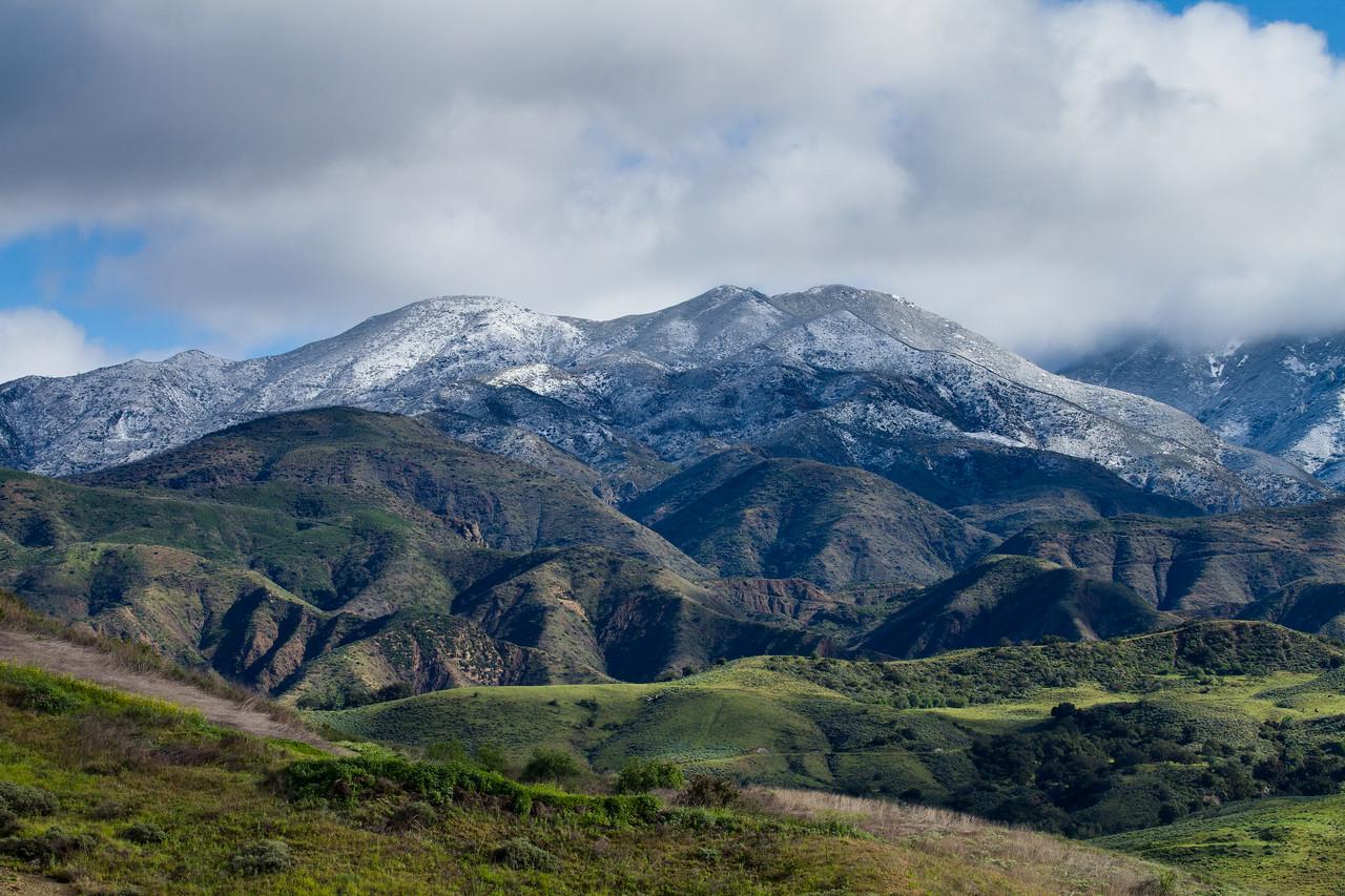 modjeska peak of Saddleback Mountain peaks through the clouds.