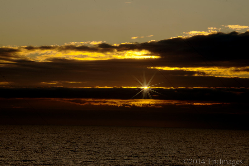 Feb 5<br /> Winter Sunrise<br /> <br /> 7:16 am ... the sun peeks through the clouds over the Atlantic