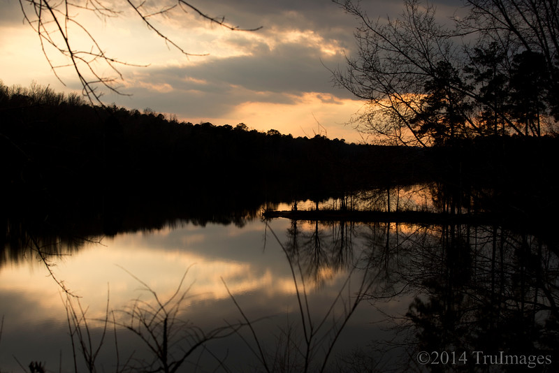 Feb 26<br /> Reflected sunset<br /> <br /> A clam section of Jordan Lake reflects the evening sunlight.<br /> <br /> I've been sick with a cold/flu so commenting has been sporadic! Will try to catch up as soon as I feel better!