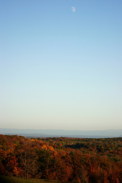 Late afternoon in autumn with the moon shining on the Catskill Mountains in upstate New York
