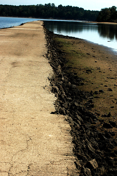A drought exposes an old highway below the waters of Jordan Lake.