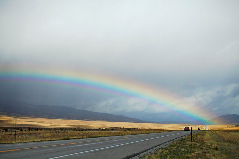 Rainbow across highway, Colorado
