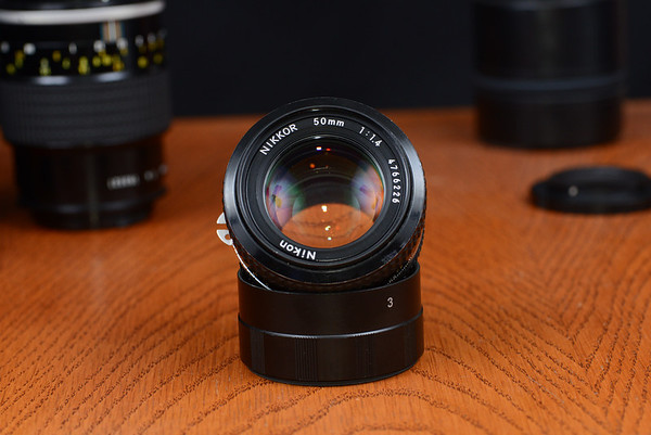 Nikon 50mm f/1.4 AI Focus ring is a bit stiff, aperture fine.  Optics clear except for the usual tiny dust. (Sold now)