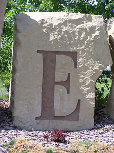E, (etched stone)