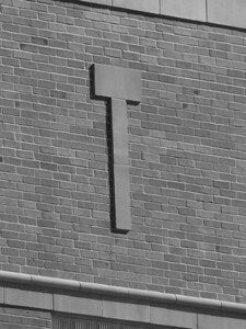 T, stone decor on brick office building in downtown Boise, ID