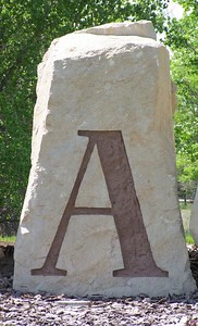 A, (etched stone)