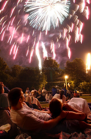 Lenny Belvin and his fiance Rachael Pawlak watch the fireworks while she cuddles their daughter Alayshis Belvin 5 months.  Shot on the hilltop at Dawes St.Celebration on the Fourth of July in the Akron area. Images made 7-4-03  Lew Stamp. Not for sale