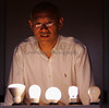 TCP, Inc. CEO, Ellis Yan, with a line of his compact fluorescent bulbs, which each produce as much output but in total, use only as much energy as the standard 60 watt  bulb at right,  on October 4, 2007 in Aurora, Ohio.  (Lew Stamp/Akron Beacon Journal)
