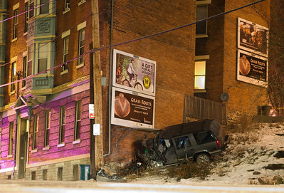 Vehicle crashes into building on Vine St. just north of McMicken Feb 1 2009
