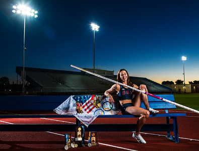 American Olympian Pole Vaulter April Steiner-Bennett clear dusk shot in Mesa, AZ, Mountain View High School