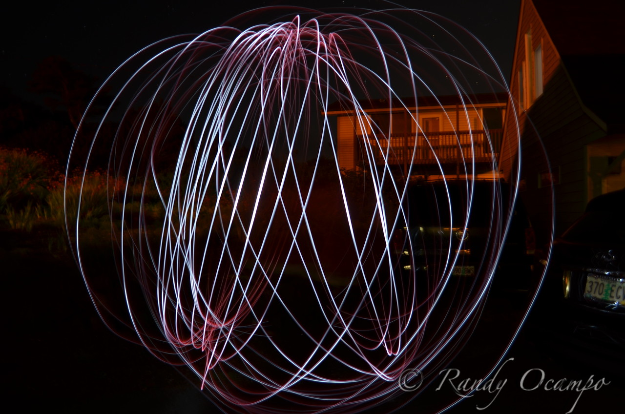 I took this picture while giving a family member, Alyssa Latham, a lesson in light painting photography.  Alyssa is spinning in circles while twirling an led light on the end of a string.