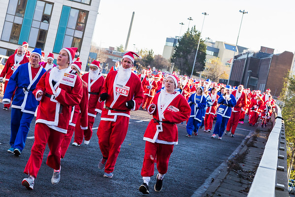 Santas descend down the flyover