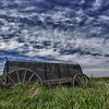 Wagon with living sky, Southwest Sask.