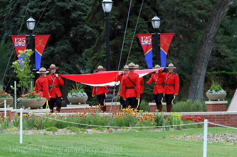 RCMP lower the flag as part of the Sunset Ceremony. Regina Saskatchewan
