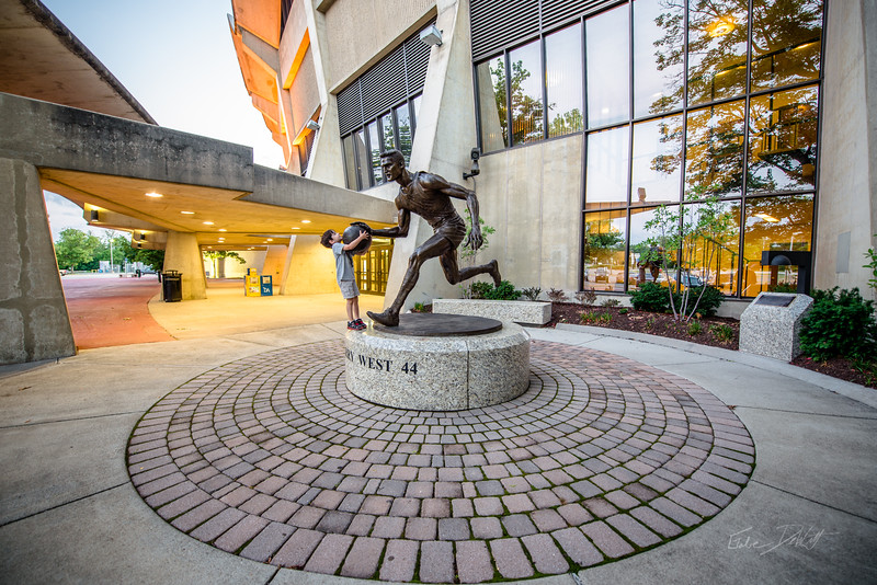 Many generations of Morgantown residents are already familiar with Jamie's work. With each visit to the WVU Coliseum, they see Jerry West making his fast break to the basketball hoop. http://www.morgantownmag.com/morgantown/October-November-2012/Breaking-the-Mold/