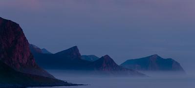 Looking across Mærvollveien towards Bjørnarøya. On the road to Unstad Beach. Sunset, Lofoten Islands. Norway 2015.