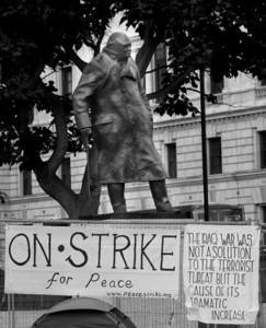 Churchill statue and anti-war posters, London