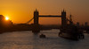 Thames dawn over London's Tower Bridge and HMS Belfast.