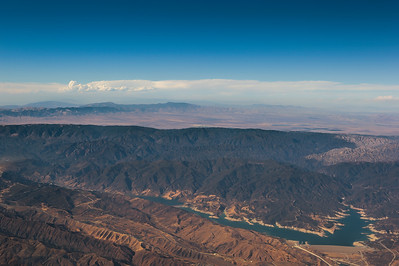 North of LA approaching the Mojave Desert on a flight from LAX to Dubai. Lake Castaic. Angeles National Forest.