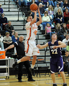 "Sports - June 2009  This was taken during a Jonesville vs Athens Basketball game.  Notice the Athens coach doing his best to ""move the basket""."