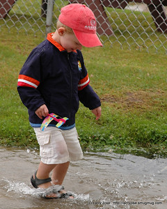 Weather, August 2008  The puddle was just too good to pass up.