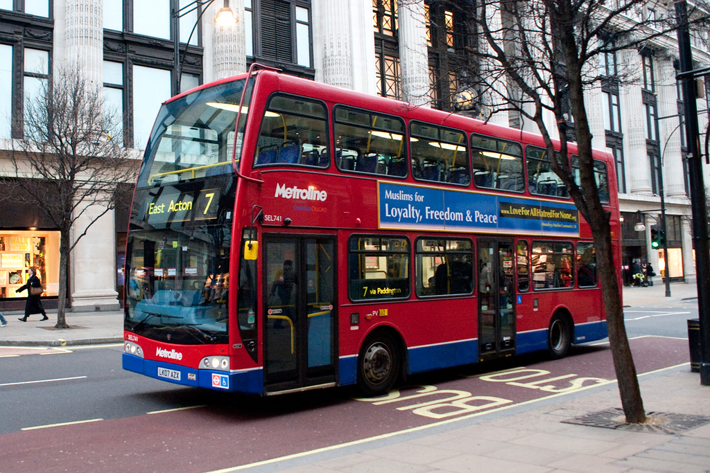 London Transport Bus in Oxford Street  with AMA UK peace message.