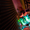 HDR image of a speaker cover with drum blurred in the background