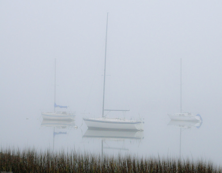 Sailboats at Folly Landing in early morning fog