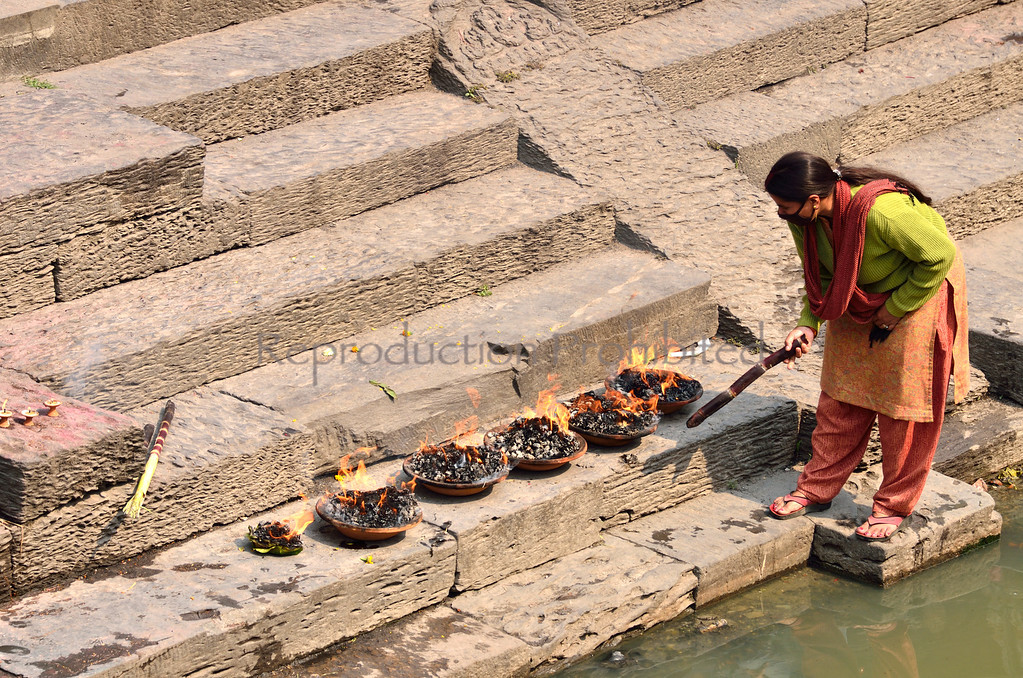 Woman Tending Fires Pashupati, Nepal